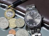 Wrist watch. coin. close — Stock Photo