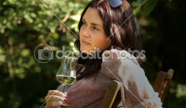 Drinking wine in garden — Stock Video