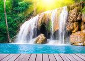 Waterfall with wood bridge — Stock Photo