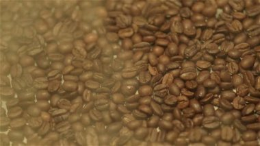 Steamy coffee beans, close-up — Stock Video