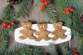 Christmas gingerbread cookies on wooden background  — Stock Photo