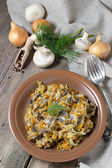 Stewed cabbage with mushrooms and carrot — Stock Photo