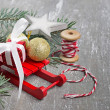 Christmas composition with sledges, fir branch, gift box — Stock Photo #60283931