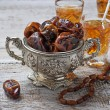 Traditional arabic tea and dry dates — Stock Photo #72529579
