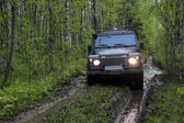 Land rover defender in Russia — Stock Photo