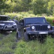 Russia, Karelia, July 16, 2015: Photo of jeep Wrangler and Mitsubishi Pajero Sport on the Karelian forest road in Russia. Wrangler is a compact four wheel drive off road and sport utility vehicle, manufactured by American automaker Chrysler. — Stock Photo #79113718