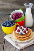 Pancake with curd and fresh berries and a bottle of milk — Stock Photo