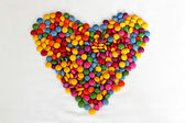 Sweet bonbons candy in heart shaped — Stock Photo