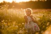 Child outdoors in summer  field — Stock Photo