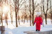 Portrait of a little girl in winter having fun with snow — Stock Photo
