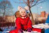 Winter, snowman - lovely girl has a fun in snow — Stock Photo
