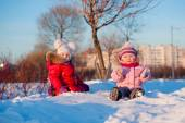 Happy friends in winterwear looking at camera outside — Stock Photo