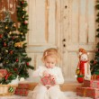 Cute Happy little girl with Christmas gifts — Stock Photo #58738713