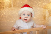 Cute little baby boy in Santa hat — Stock Photo