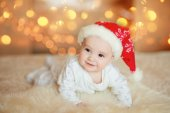 Attractive little baby boy in Santa hat — Stock Photo