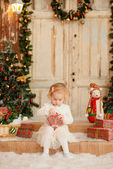 Cute Happy little girl with Christmas gifts — Stock Photo