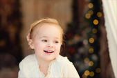 Smiling happy little girl at the christmastime — Stock Photo