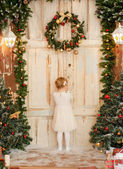 Little girl in Santa's waiting — Stock Photo