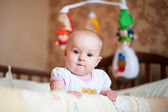 Portrait of baby girl in bed. — Stock Photo