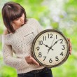 Pretty young woman with clock — Stockfoto #62732899