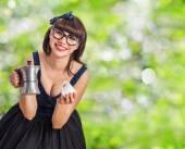 Pretty pinup woman serving coffee — Stock Photo