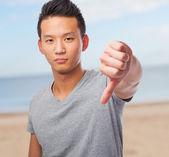Asian man doing negative gesture — Stock Photo