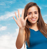Elegant young girl counting with fingers — Stock Photo