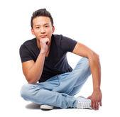 Asian man posing sitting — Stock Photo