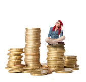 Young woman sitting on coins tower — Stock Photo