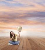 Pretty woman sitting on wooden floor — Stock Photo