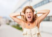 Stressed young girl covering ears — ストック写真