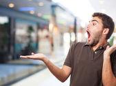 Surprised man holding something — Stock Photo