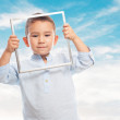Little boy looking through frame — Stock Photo #62756775