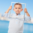 Little boy looking through frame — Stock Photo #62756781