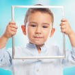 Little boy looking through frame — Stock Photo #62756789