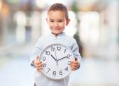 Little boy holding clock — Foto Stock