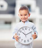 Little boy holding clock — Stock Photo