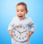 Little boy holding clock — Fotografia Stock