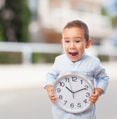Little boy holding clock — Stock Photo