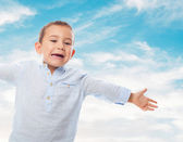 Little boy opening his arms — Stock Photo