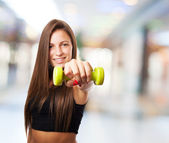 Pretty young girl holding weights — Stock Photo