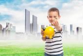 Little boy putting money into piggybank — Stock Photo