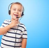 Little boy talking by headset — Stock Photo