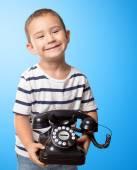Little boy holding telephone — Stock Photo