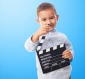 Little boy holding clapper board — Stock Photo