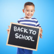 Cute kid holding chalkboard — Stock Photo #62765781