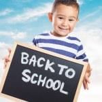 Cute kid holding chalkboard — Stock Photo #62765783