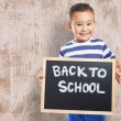 Cute kid holding chalkboard — Stock Photo #62765789