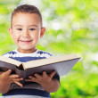 Cute kid holding big book — Stock Photo #62765801