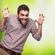 Young man doing aggressive gesture — Stock Photo #62768057
